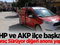 MHP ve AKP İlçe başkanı biri araç Sürüyor diğeri anons yapıyor